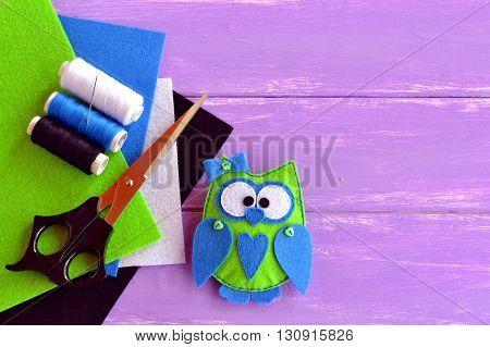 Felt hand print owl stuffed toy. Felt owl softie toy. Hand-sew owl. Baby toy. Handmade sewn thread. Crafts hand made. Decorative owl crafting. Pieces of felt, scissors, a set of thread