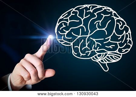 Close up of male hand touching brain on blue screen