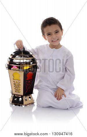 Happy Young Boy With Big Fanoos Celebrating Ramadan