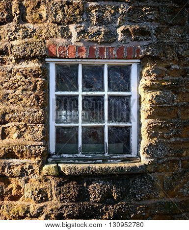 WYMONDHAM ENGLAND - JANUARY 15: Close up of an old window on the exterior of Wymondham windmill. In Wymondham England on 15th January 2016.