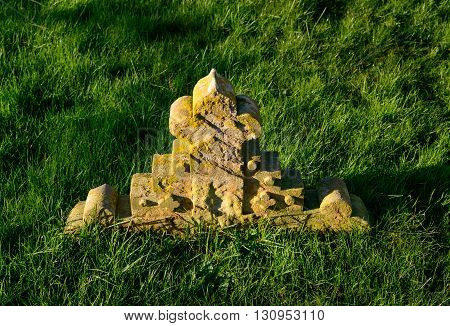 WYMESWOLD ENGLAND - JANUARY 15: A sunken grave stone within the graveyard of St Mary's church. In Wymeswold England on 15th January 2016.