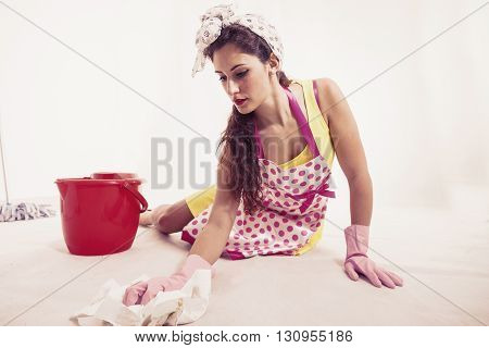 Pretty Housemaid With Cloth And Bucket Cleaning The Floor