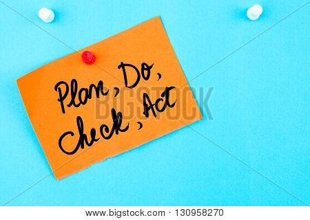 Plan, Do, Check, Act Written On Orange Paper Note