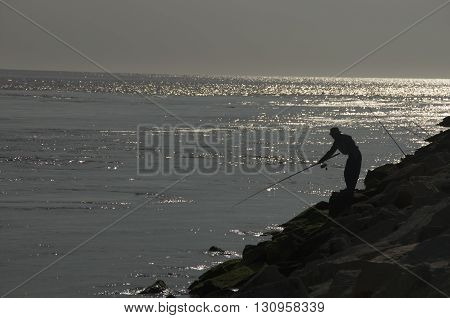 A fisherman goes for a good catch in the Delaware Seashore Park
