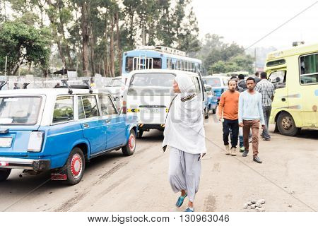 ADDIS ABABA ETHIOPIA - 13 August 2015: Unidentified people in the cahotic streets of Addis Ababa where without a single traffic light vehicles and pedestrians simply go around trying not to bump