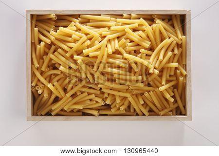 maccheroni pasta on the white background