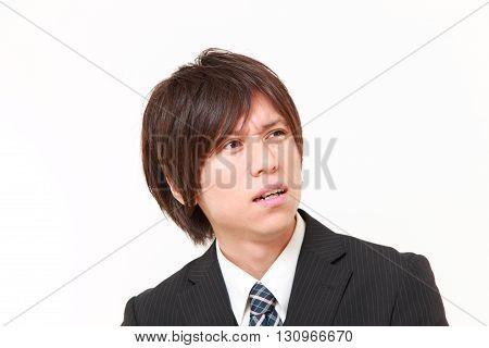 portrait of perplexed businessman on white background