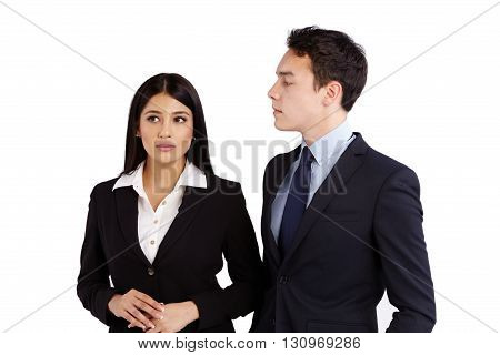 Young Business Man Looking At A Business Woman Disapprovingly
