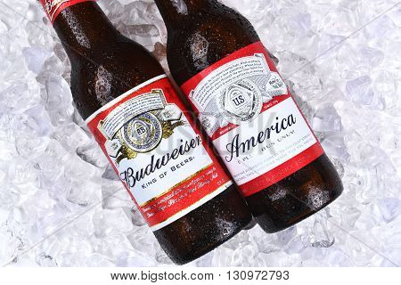 IRVINE CA - MAY 21 2016: Two Budweiser Beer Bottles on ice. A limited edition America bottle and a traditional label from Anheuser-Busch.