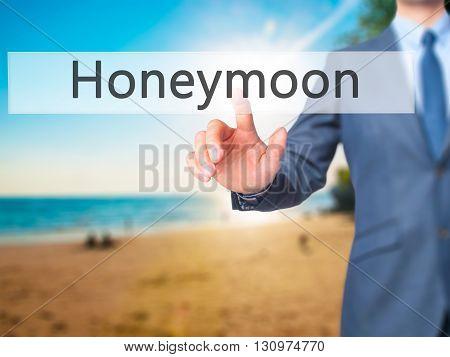Honeymoon - Businessman Hand Pressing Button On Touch Screen Interface.