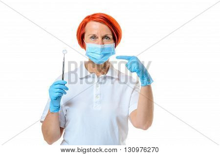 Red Headed Female Dentist With Gloved Hands