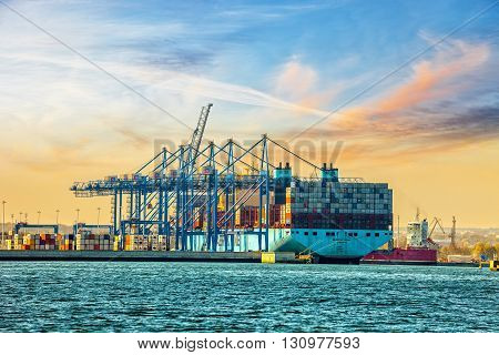 GDANSK, POLAND - MAY 7, 2016: The container ship Maersk one of the worlds largest container ship is loaded unloaded at DCT Gdansk deep-sea terminal. DCT Gdansk received its first vessel on the 1st of June 2007.