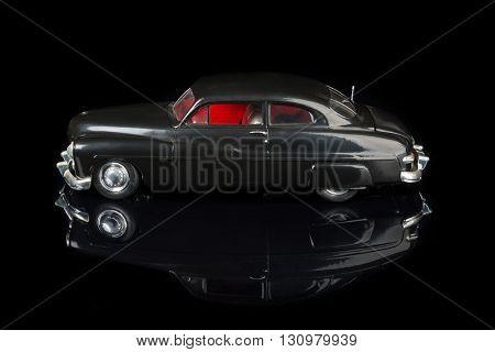 Vintage Car Model on Black Background
