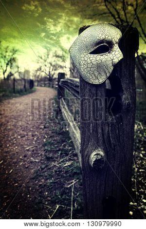 Vintage Venetian Mask on Fence Post