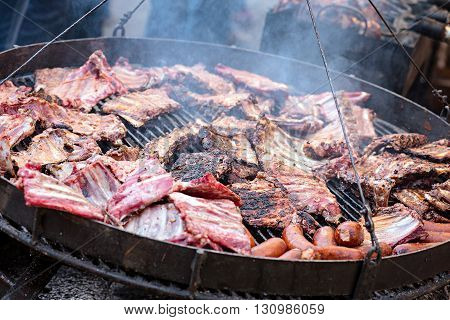 group of Grilled pork ribs on the grill.
