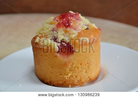 blueberry muffin in dish on wooden chop block
