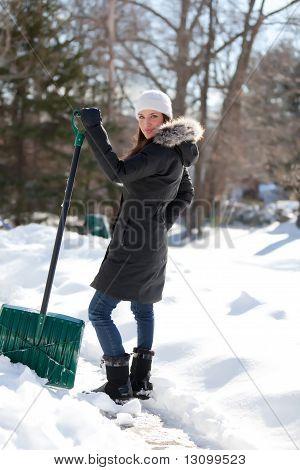 Woman Shoveling Sidewalk
