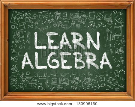 Learn Algebra - Handwritten Inscription by Chalk on Green Chalkboard with Doodle Icons Around. Modern Style with Doodle Design Icons. Learn Algebra on Background of  Green Chalkboard with Wood Border