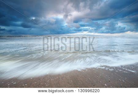 North sea coast and rainy sky North Holland Netherlands
