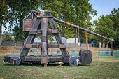 Old medieval catapult (reconstruction) in a park poster