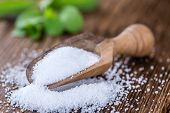 Old wooden table with Stevia Granules (selective focus; close-up shot) poster