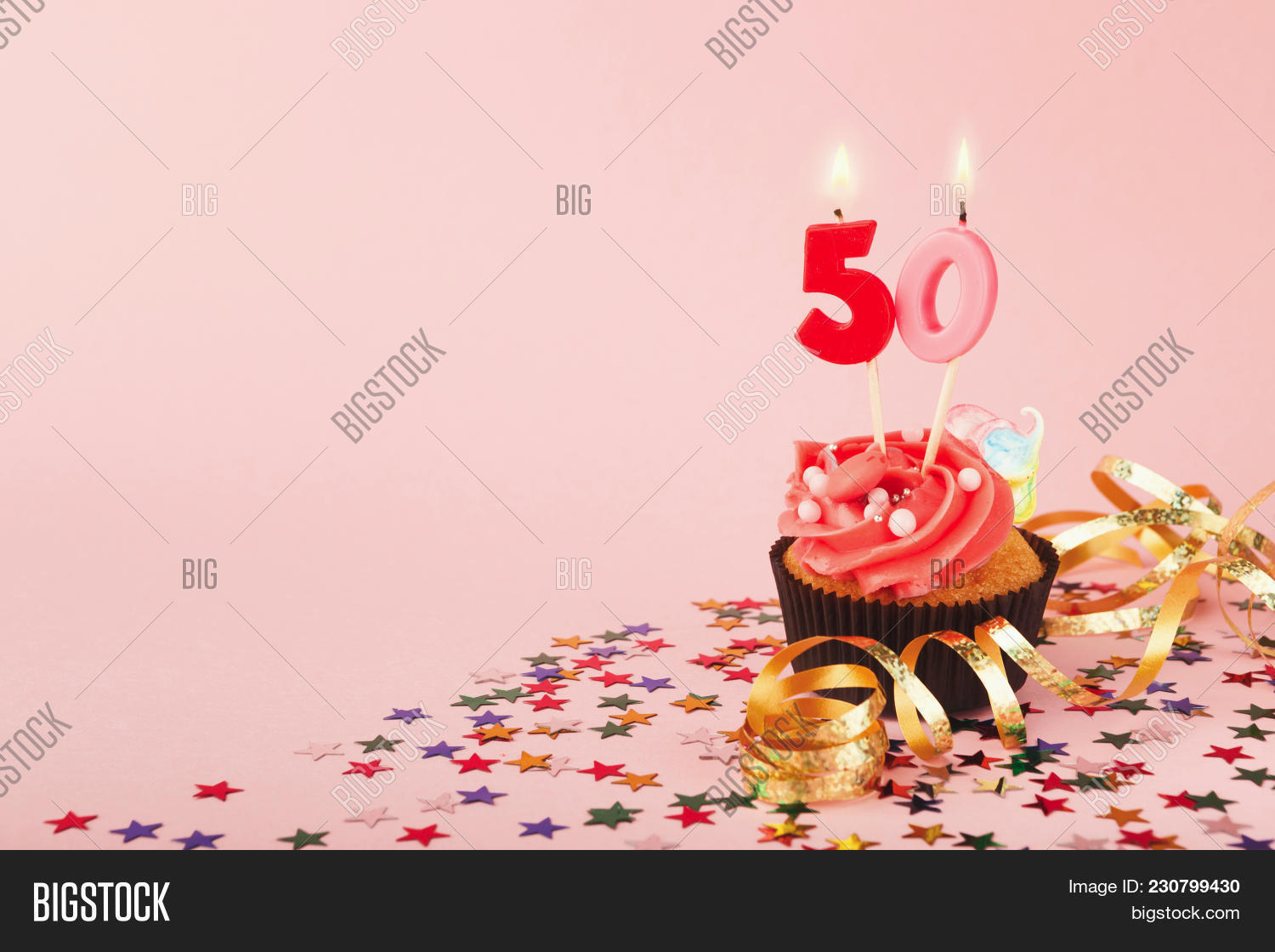 50th Birthday Cupcake With Candles Sprinkles And Ribbon On Pink Background Card Mockup Copy Space Party Holiday Concept