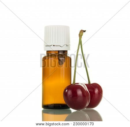 Aromatic Liquid For Electronic Cigarettes Smoking, Two Ripe Cherries Isolated On White Background