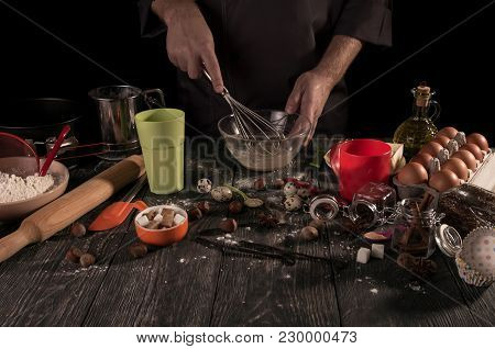 Baker's Hands Whipped With Whisk Quail Eggs In Bowl Isolated On Black