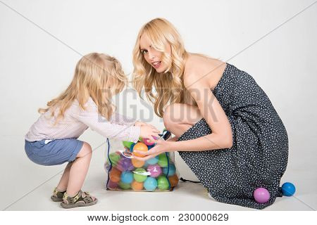 Mother And Child, Relatives. Happy Family Play With Toy Balls. Mothers Day, Family Values, Trust, Ch