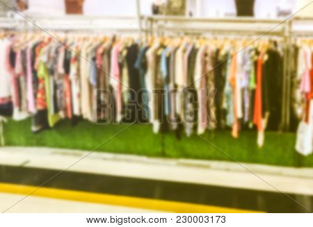 Blur Image - Many Second Hand Female Clothes Hanging On The Rail In The Shop.