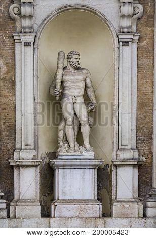 Statue Of Hercules With A Three Headed Dog At Entrance Of The Ducal Palace In Modena, Italy. Sculpur