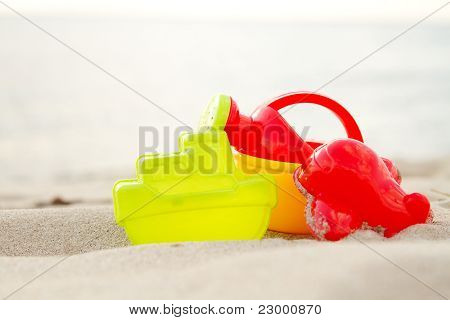 Group Of Children Beach Plastic Toys On Seacoast ..