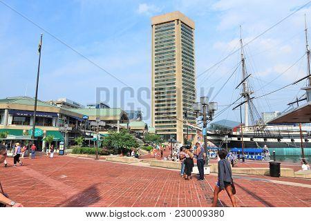 Baltimore, Usa - June 12, 2013: People Visit Inner Harbor In Baltimore. Inner Harbor Is A Historic S