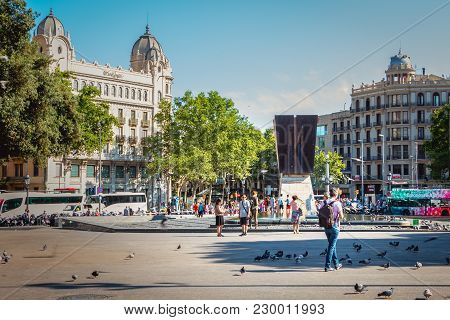 Barcelona, Spain - June 20, 2017 : People Are Walking On The Plaza De Catalunya (plaça De Catalunya)