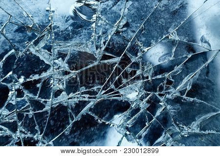 Cracked glass detail with dark background