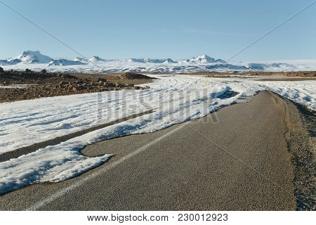 Scenic road coverd with ice and snow in the Icelandic Highlands