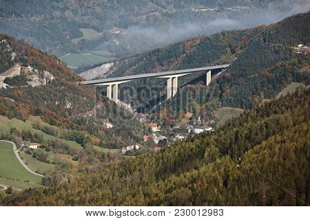 Alpine valley with highway viaduct