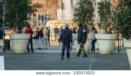 Milan, Italy - November 03, 2017:  Street Vendors Sell Selfie Poles To Tourists In Front Of The Cast