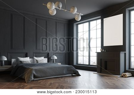 Stylish Master Bedroom Corner With Black Walls, A Black Bed And A Fireplace With A Poster Above It.