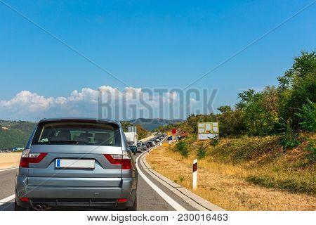Cars Are In A Traffic Jam On The Highway In Croatia. Space For Text