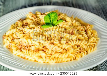Close-up Of Traditional Italian Spaghetti Or Fusilli With Meat Stuff On Wooden Background