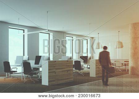 White And Wooden Office Cubicles With Computer Desks Inside. A Round Column In The Corner. Concept O