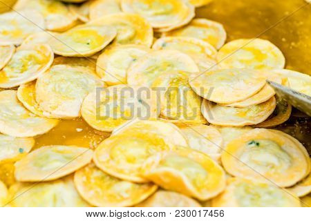 Close Up Of Dumplings Stuffed With Potato Or Pelmeni. Traditional Russian Cuisine.