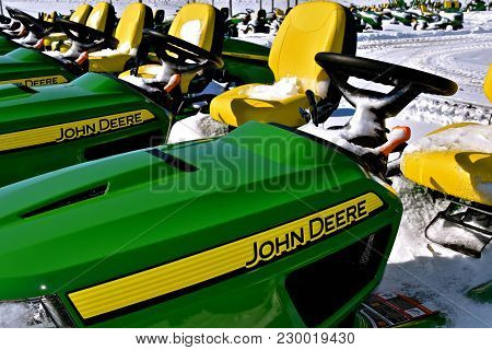 Moorhead, Minnesota, March 5, 2018: The John Deere  Lawn Tractor S Covered With Snow Are Products Of
