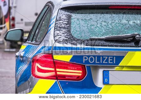 Polizei Is The German Word For Police - Here Written On The Back Of The Police Car.
