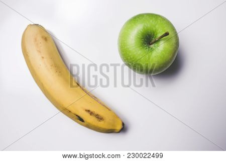 Banana And Green Apple On White Background