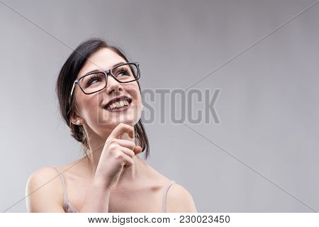 Happy Attractive Young Woman Standing Daydreaming