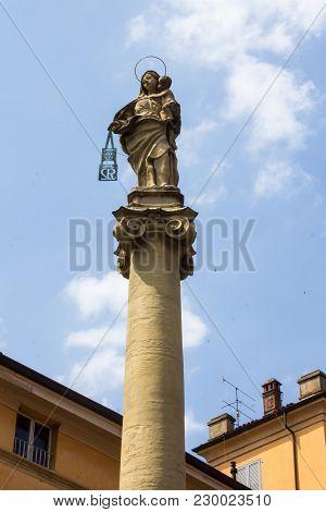 Bologna, Italy - July 22, 2017: Column Of The Beata Vergine Del Carmine On The Churchyard Of The Bas