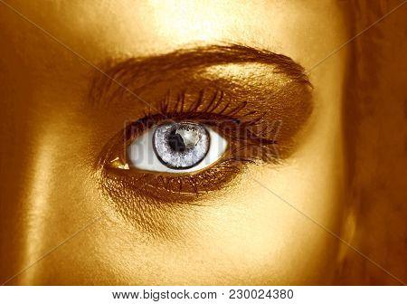 Glamour Shiny Gold Professional Makeup. Beautiful Golden Skin Close Up.