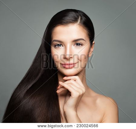 Cute Woman With Beautiful Long Straight Hair. Haircare Concept